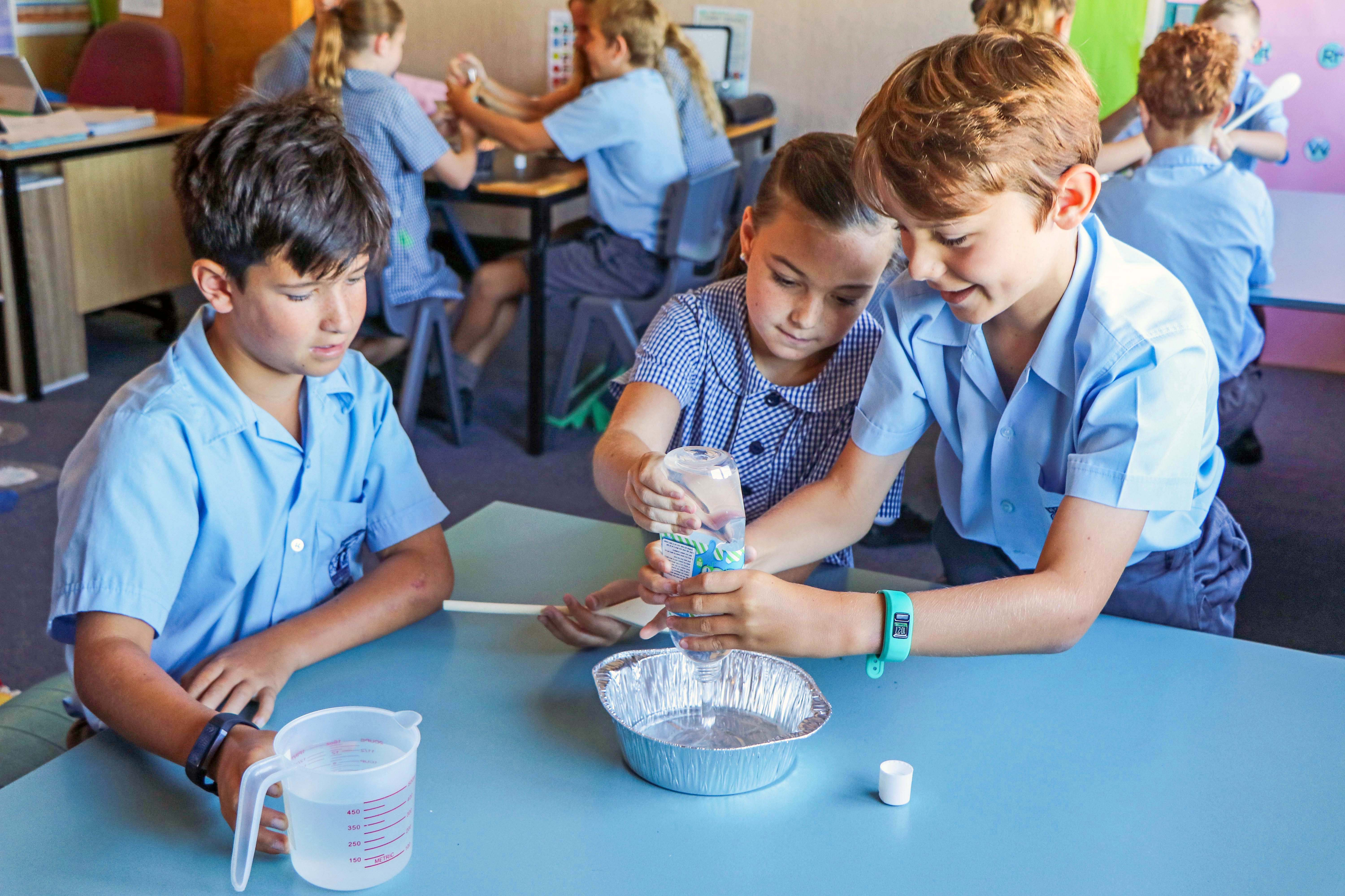 students performing science experiment